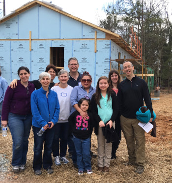 Kehillah volunteer builders, with the Marquez family.